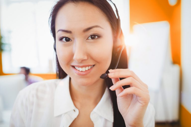 happy call center agent with headset