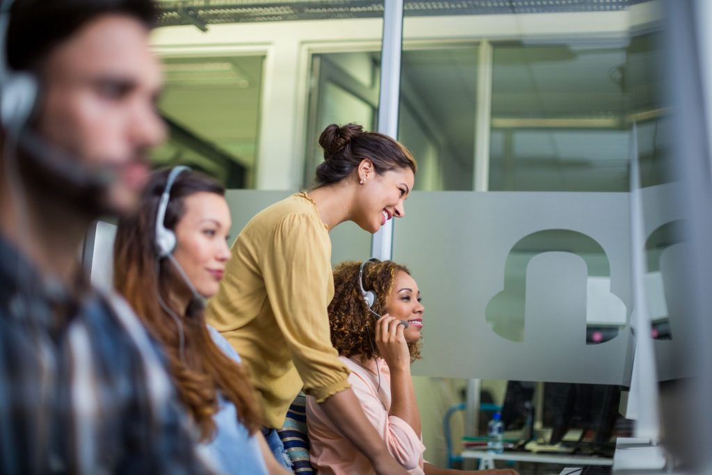 contact center agents working to break free from their call center script using call center scripting software
