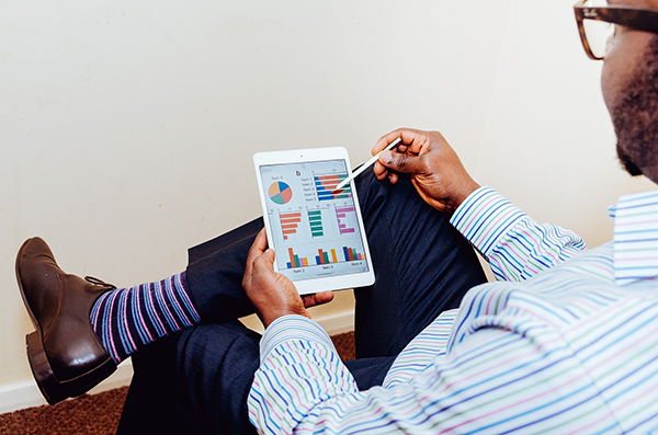 businessman reviewing analytics on tablet