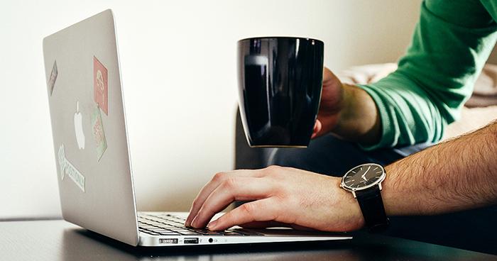 consumer with mug shopping online ecommerce