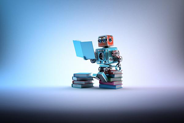 robot looking at laptop