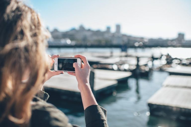 woman taking photo on phone