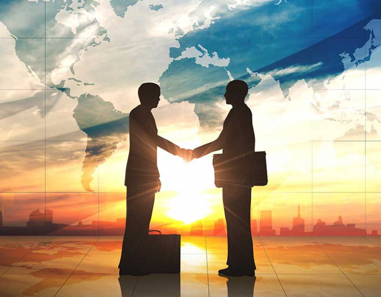 silhouette of professionals shaking hands