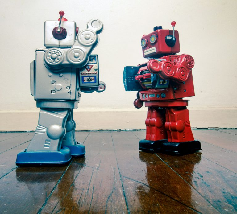 silver and red robots fighting