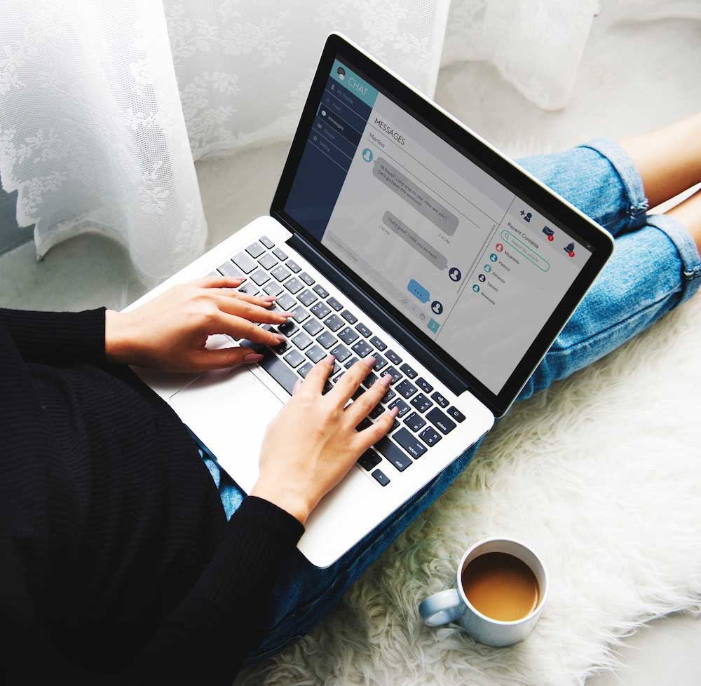 woman live chatting on laptop