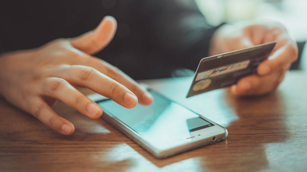 Person purchasing on mobile using credit card