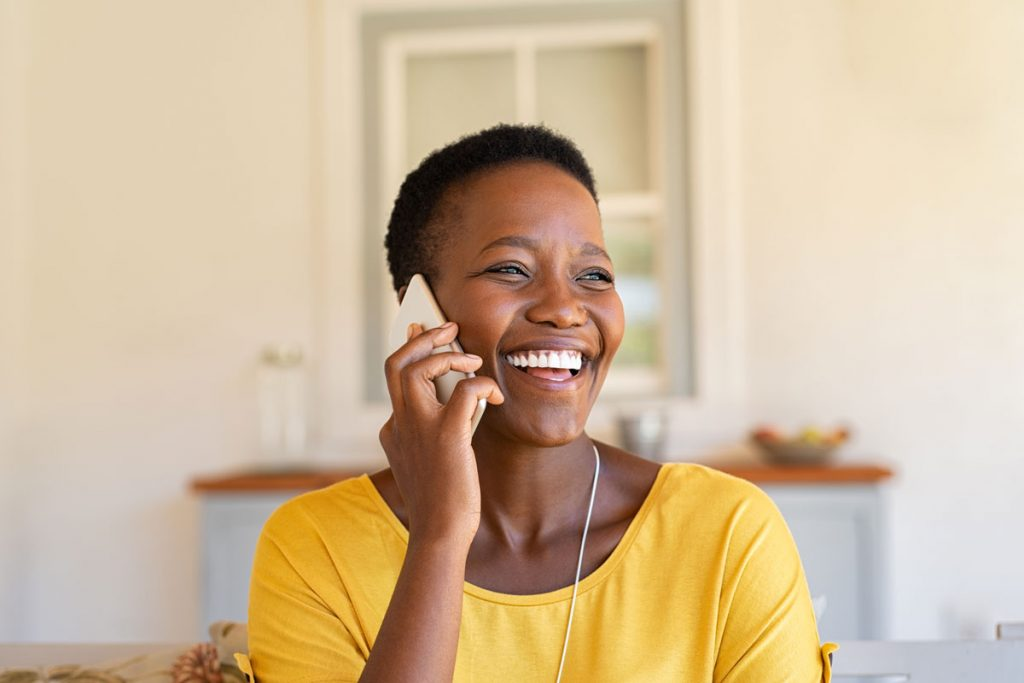 happy customer talking with a conversational ivr on the phone
